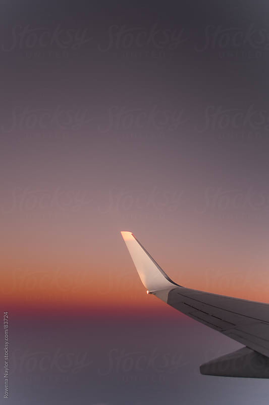 Wing of a commercial airline during flight by Rowena Naylor for Stocksy United