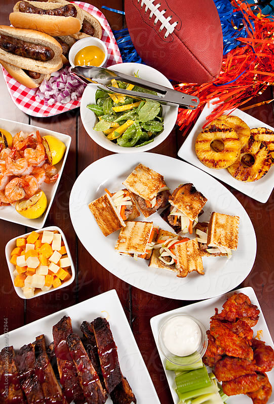 Tailgate Food: Overhead View of Food Including Pork Burger Slide by Sean Locke for Stocksy United