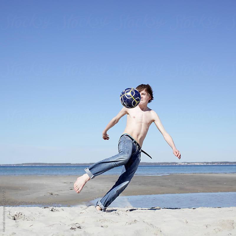 beach soccer boy by Marcel for Stocksy United