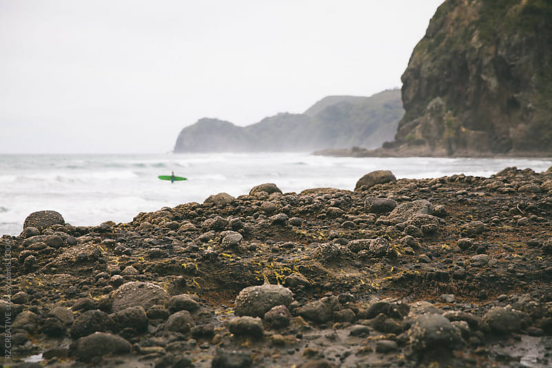 Surfing in New Zealand. by Robert Zaleski for Stocksy United