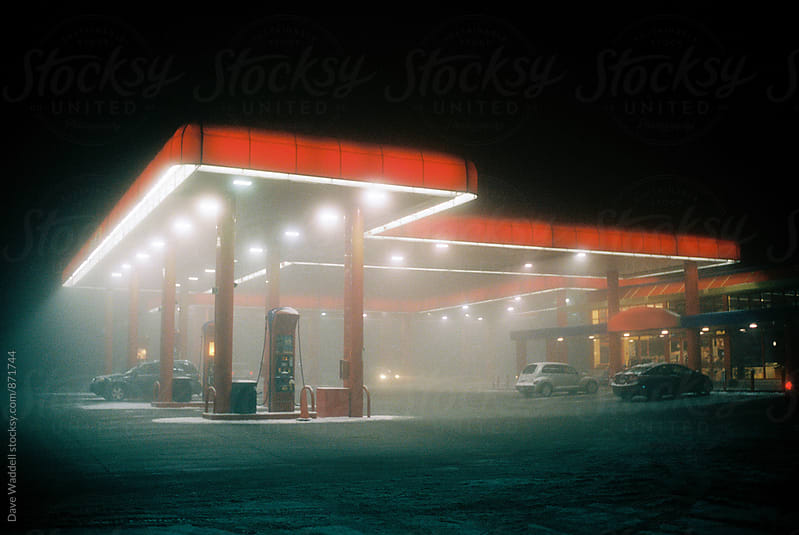 Gas Station on a Foggy Night by Dave Waddell for Stocksy United