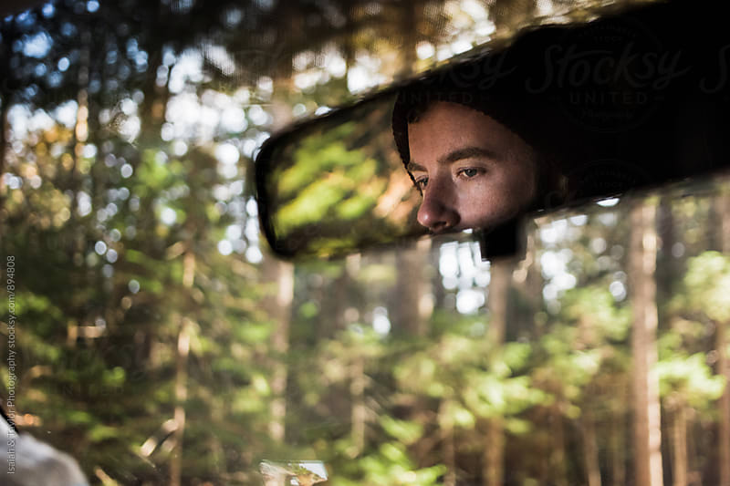 Man in rearview mirror by Isaiah & Taylor Photography for Stocksy United