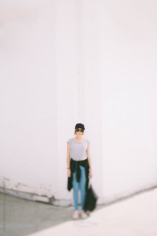 student girl with backpack on the white background by Alexey Kuzma for Stocksy United