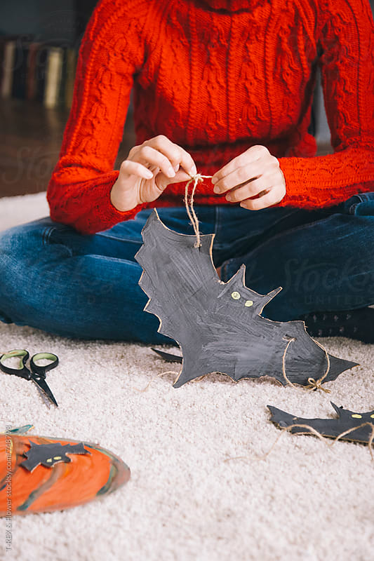 Woman crafting halloween bat by Danil Nevsky for Stocksy United