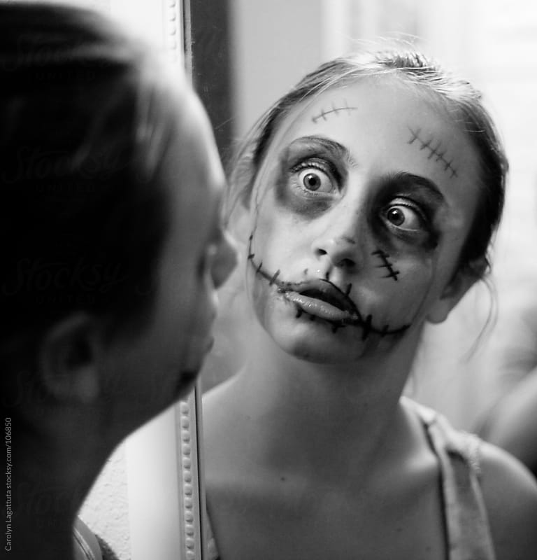 Crazed zombie looking at herself in the mirror by Carolyn Lagattuta for Stocksy United