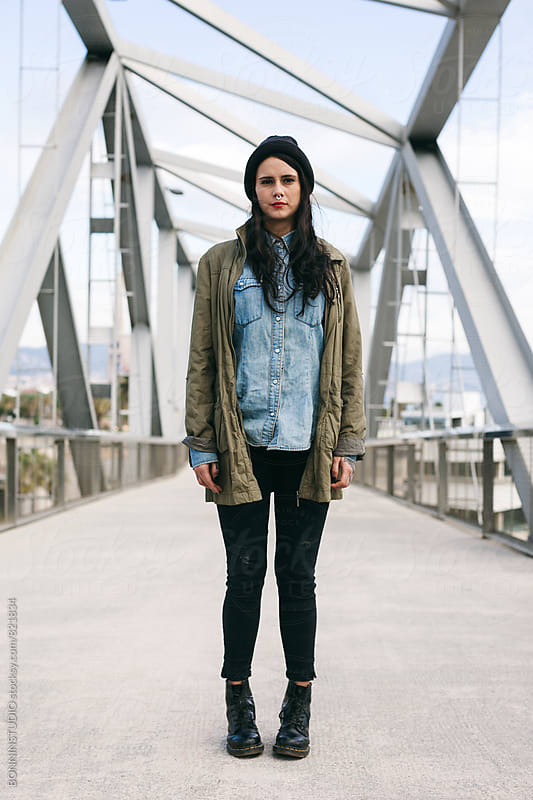 Portrait of an alternative woman standing on a modern bridge. by BONNINSTUDIO for Stocksy United