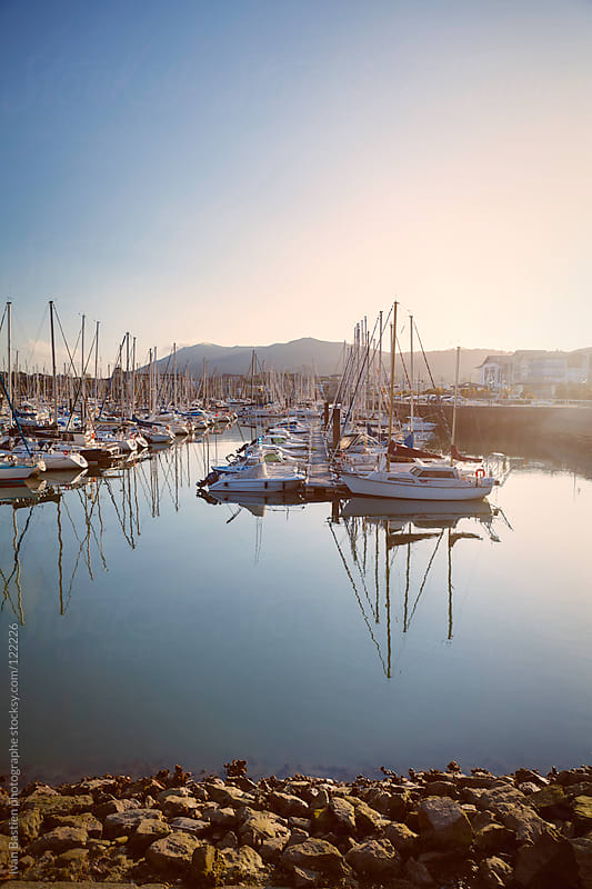 Yachts and boats in Hendaye marina at sunset by Ivan Bastien for Stocksy United
