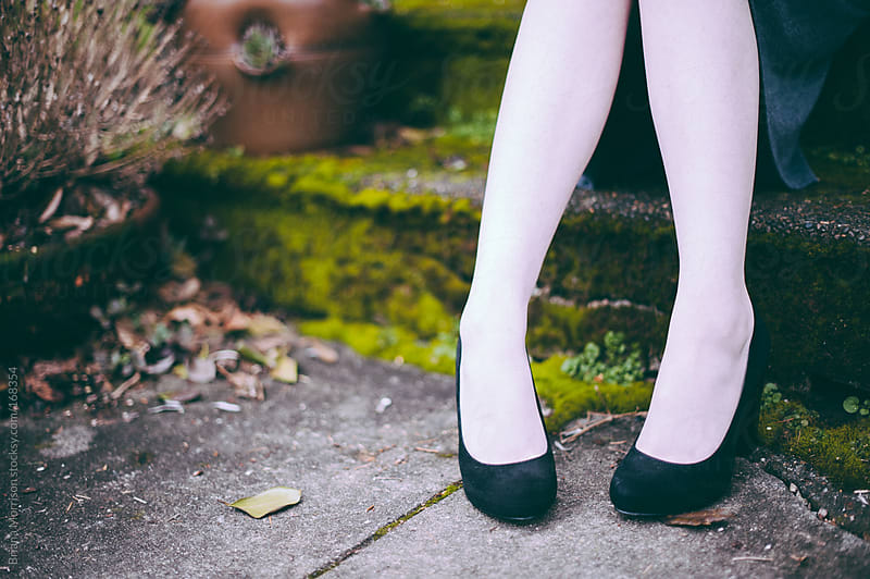 Feet in Black High Heels and White Stockings Outside by Briana Morrison for Stocksy United