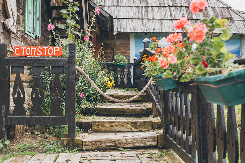 Stop sign to entry of cute village home by Jovo Jovanovic for Stocksy United