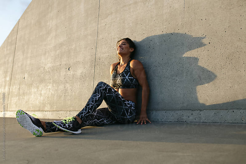 Woman taking a break during workout by Jacob Ammentorp Lund for Stocksy United