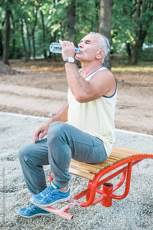 Middle-aged Man Drinking Water After Workout by Aleksandra Jankovic for Stocksy United