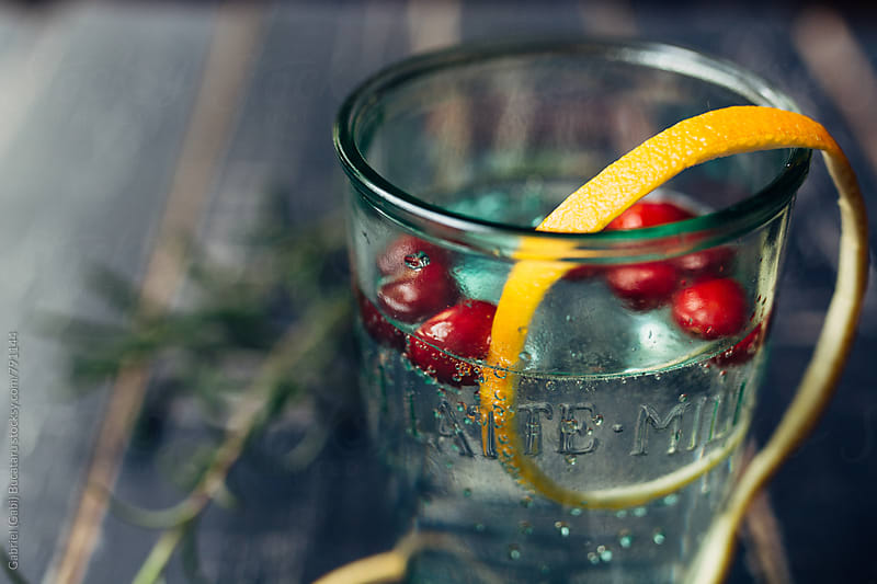 Seltzer water cup with cranberry by Gabriel (Gabi) Bucataru for Stocksy United