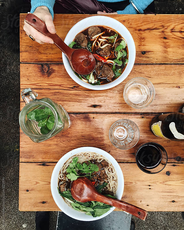 Noodles for lunch at Brixton Market by Kirstin Mckee for Stocksy United