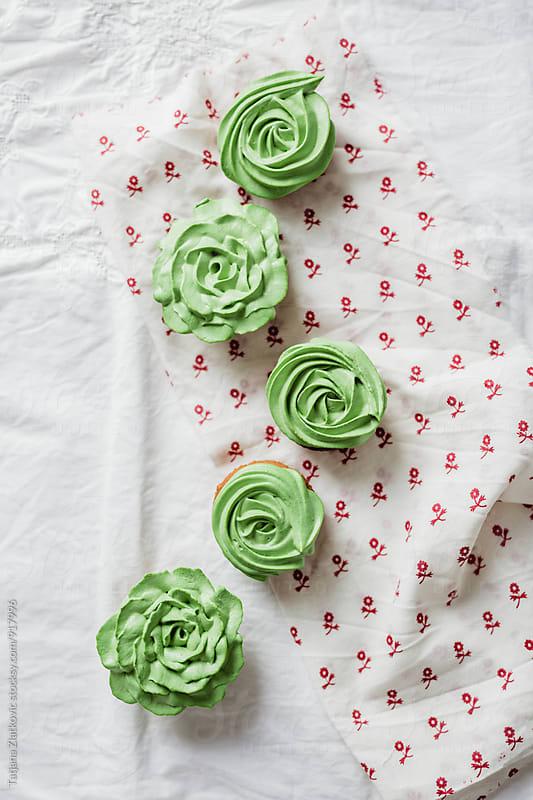 Green cupcakes by Tatjana Zlatkovic for Stocksy United