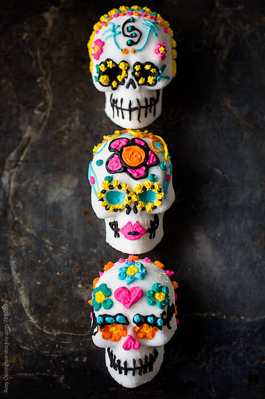 Sugar skulls decorated for Dia de los Muertos by Amy Covington for Stocksy United