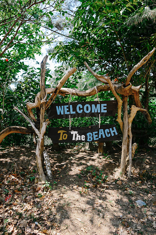 Welcome to the beach by Jose Coello for Stocksy United