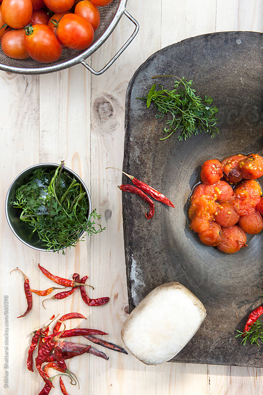 Ingredients to make Tomato Aachar. by Shikhar Bhattarai for Stocksy United