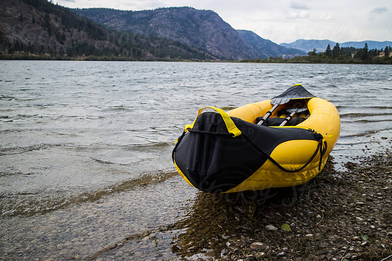 Kayak on the shore of a lake. by kkgas for Stocksy United