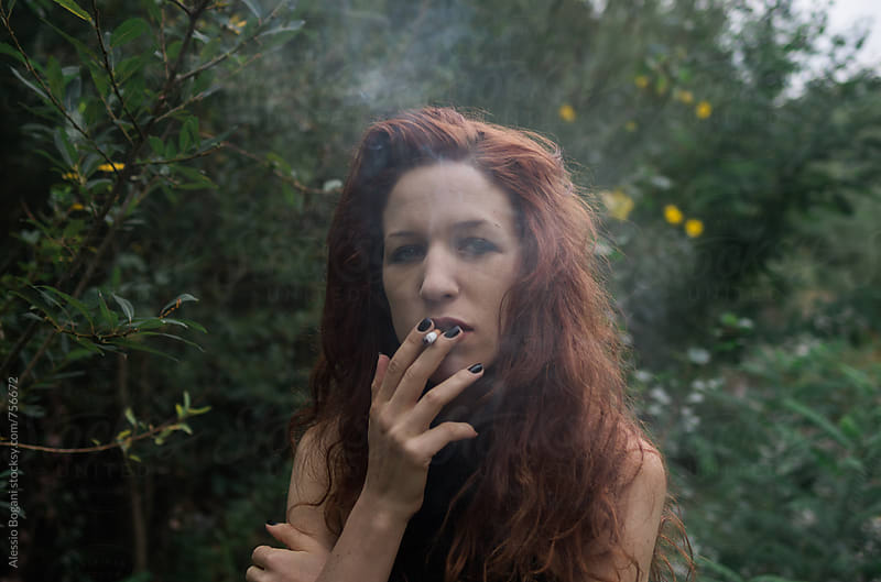Smoking redhead portrait by Alessio Bogani for Stocksy United
