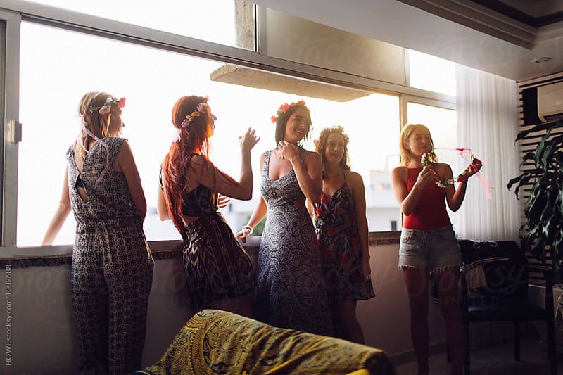 five women friends hanging out by the window by HOWL for Stocksy United