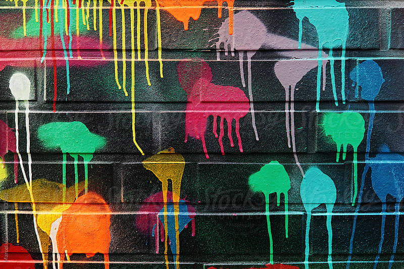 Colorful blotches of paint on a wall by Marcel for Stocksy United