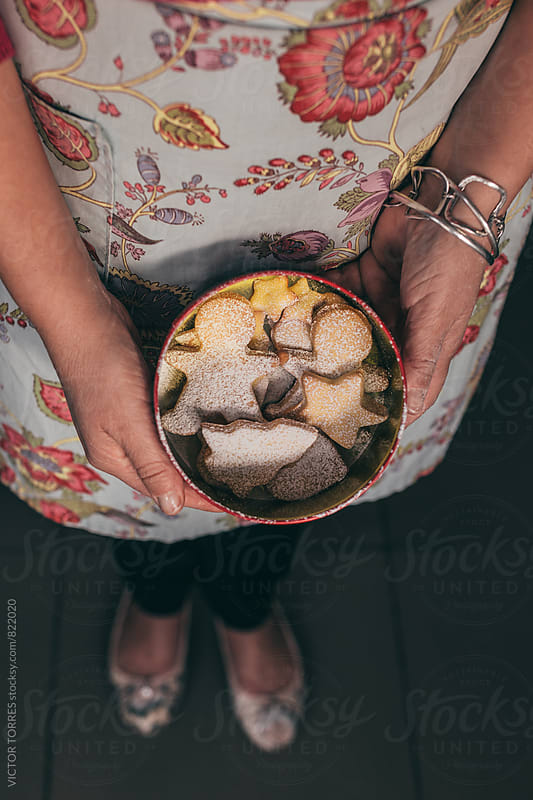 Woman Preparing Christmas Cookies at Home by VICTOR TORRES for Stocksy United