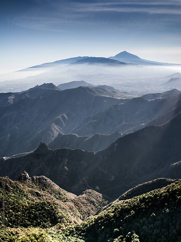 View over Macizo de Anaga mountain range to Mount Teide by Andreas Wonisch for Stocksy United