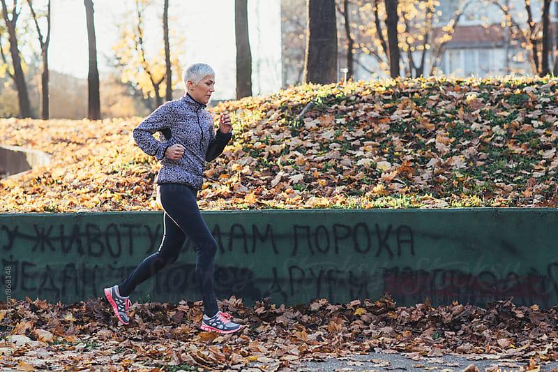 Senior Woman Ready to Run by Lumina for Stocksy United
