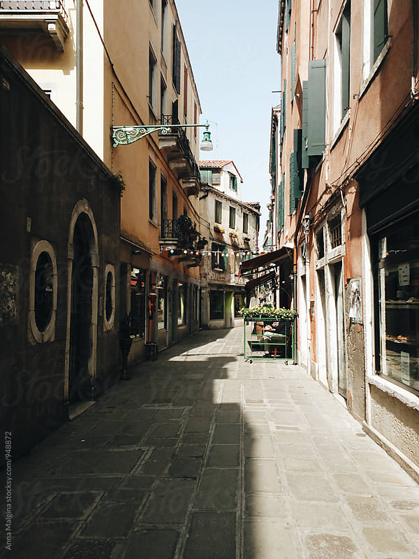 A narrow street in Venice by Anna Malgina for Stocksy United