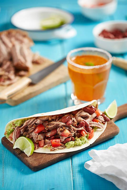 Pork meat tacos by Martí Sans for Stocksy United