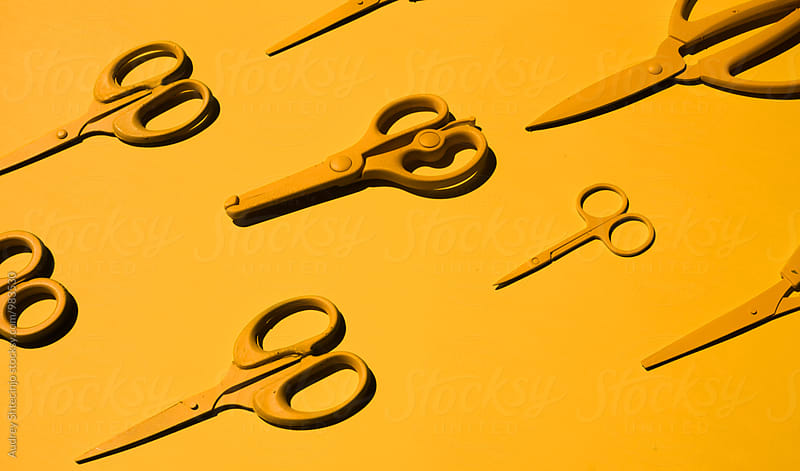 Yellow scissors on yellow background by Marko Milanovic for Stocksy United