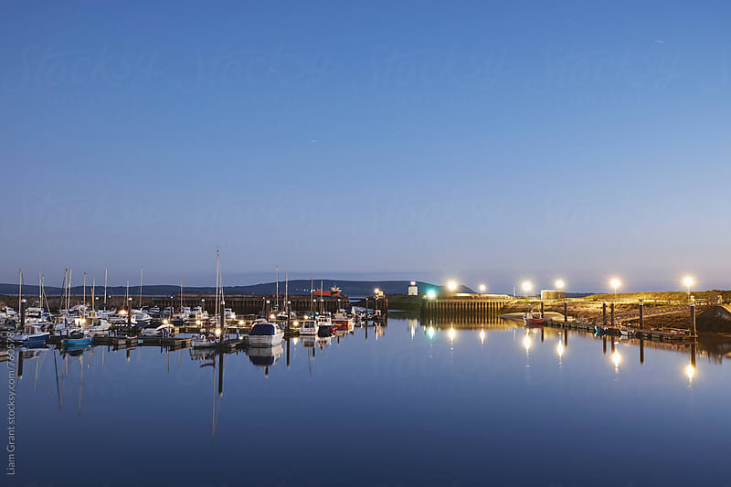 Burry Port harbour and lighthouse at night. Wales, UK. by Liam Grant for Stocksy United