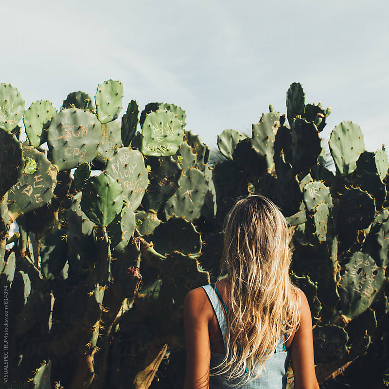Young Blond Girl Standing in Front on Cacti by Julien L. Balmer for Stocksy United