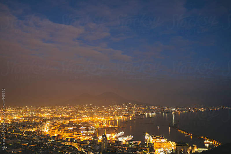 Twilight over Naples, Italy and Vesuvius in the background by Aleksandar Novoselski for Stocksy United
