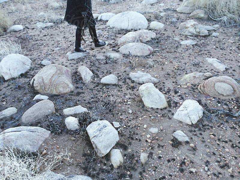 Woman Walking on Desert Rocks by Kevin Russ for Stocksy United
