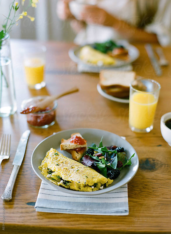 Plated omelette on table by Ali Harper for Stocksy United