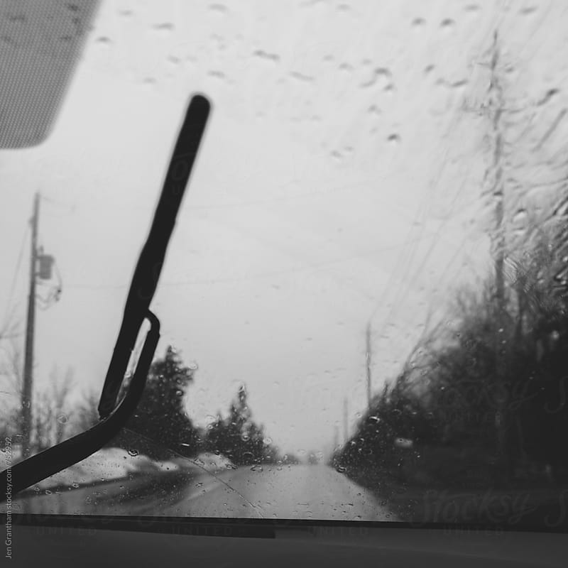 Driving in the rain by Jen Grantham for Stocksy United
