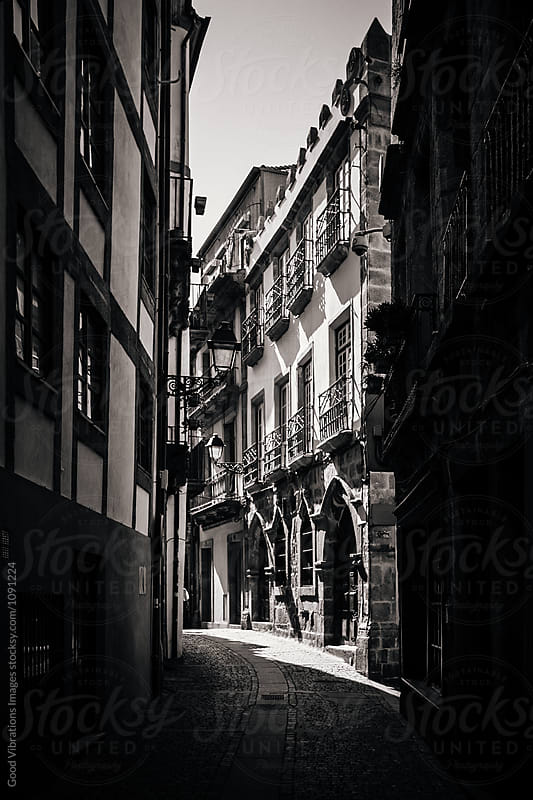 Dark alley in Oporto, Portugal by Good Vibrations Images for Stocksy United