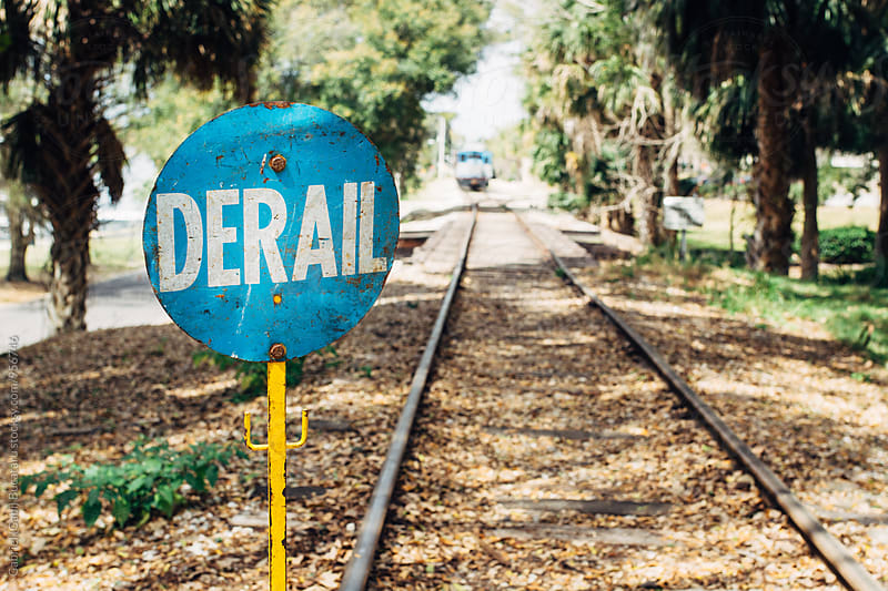 Derail warning sign on a railroad by Gabriel (Gabi) Bucataru for Stocksy United