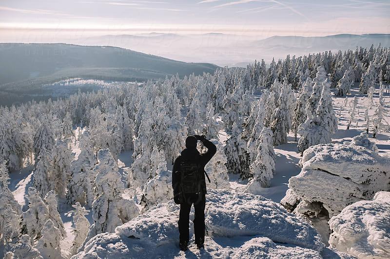 man in winter landscape by Paul Schlemmer for Stocksy United