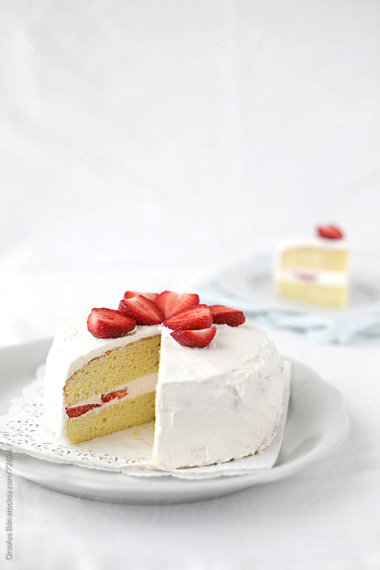 White Cake with Strawberry by Orsolya Bán for Stocksy United