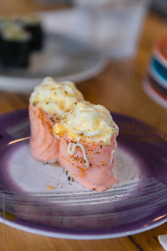 sushi with salmon, corn, potato salad and mayo by Gillian Vann for Stocksy United
