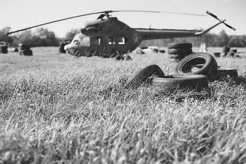 landscape with old helicopter by Alexey Kuzma for Stocksy United