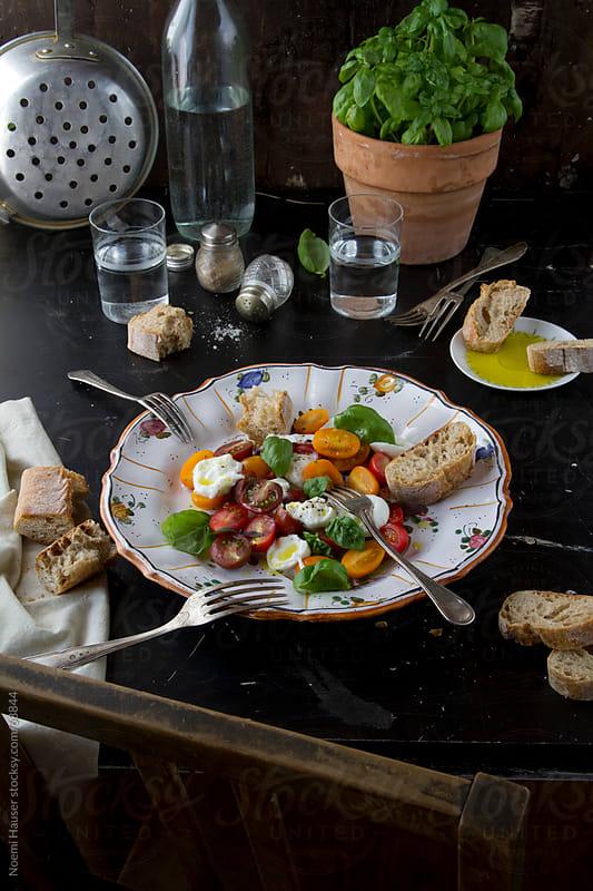 Tomato-mozzarella salad  by Noemi Hauser for Stocksy United