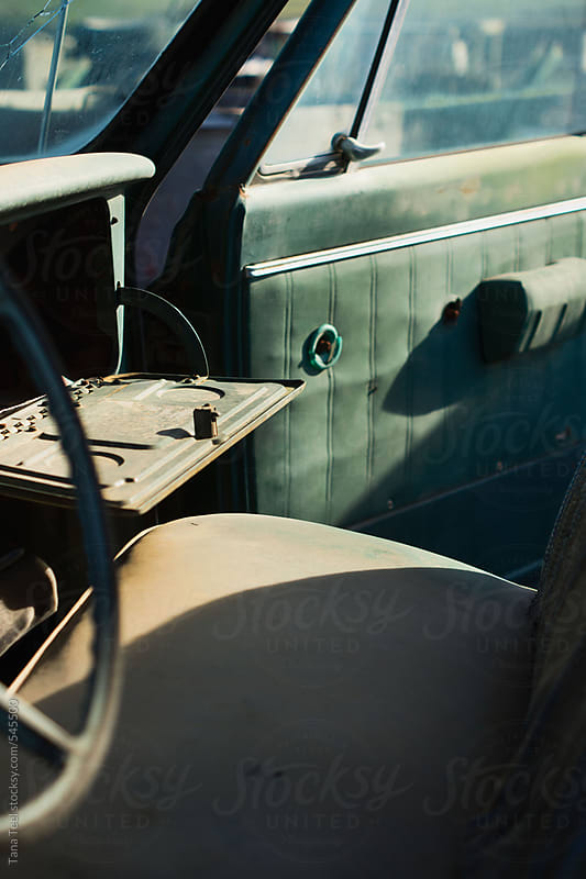 Dusty interior of abandoned old vehicle by Tana Teel for Stocksy United