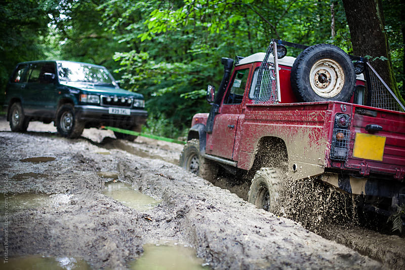 Offroad with 4x4 in the mud by Tristan Kwant for Stocksy United