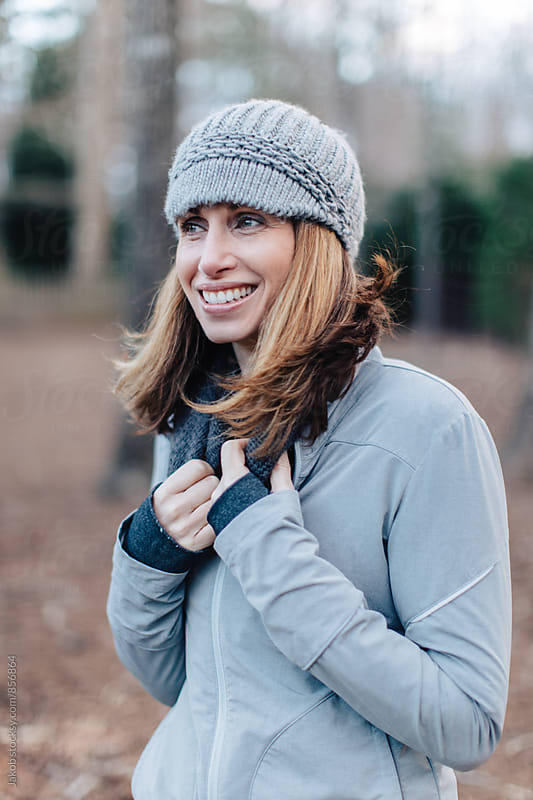 Beautiful and healthy looking woman in beanie by Jakob for Stocksy United