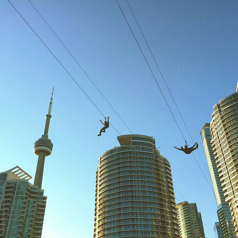 Father And Son On A Zipline Over Toronto Canada On A Clear Day by ALICIA BOCK for Stocksy United