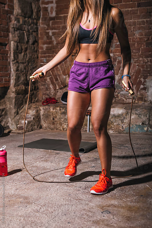 Girl with jumping-rope by Danil Nevsky for Stocksy United