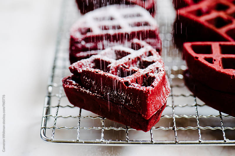 Red Velvet Cake Waffles Getting Sugared  by Cameron Whitman for Stocksy United